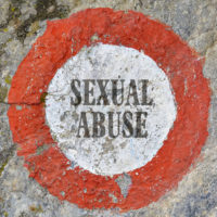 Badge that reads sexual abuse