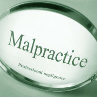 A magnifying glass that reads malpractice
