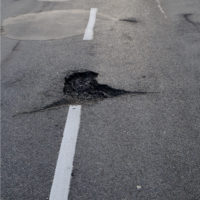pothole on road
