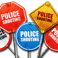 signs that read police shooting