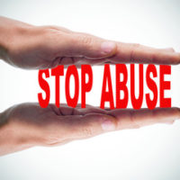 sign that reads stop abuse