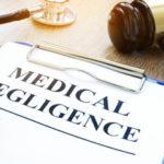 Blue clipboard Medical negligence