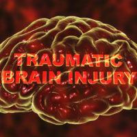 a skull with Traumatic Brain injury label inside