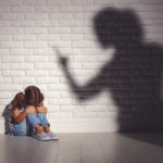 domestic violence. angry mother scolds   frightened daughter