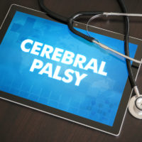 Cerebral palsy (neurological disorder) diagnosis medical concept on tablet screen with stethoscope