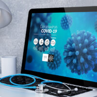 medical desktop computer with covid-19 info
