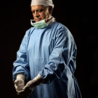 Surgeon looking at his gloves