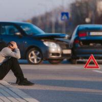 Sad man after car accident