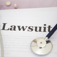 Medical Malpractice Paperwork Lawsuit Papers on desk of a doctor